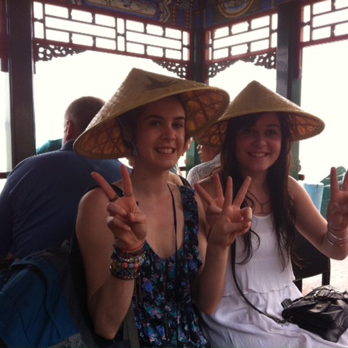 Harriet, Emma Cropper with their traditional hats on the boat
