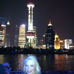 Nicole harding on cruise - Huang Pu River with Pearl Tower in background