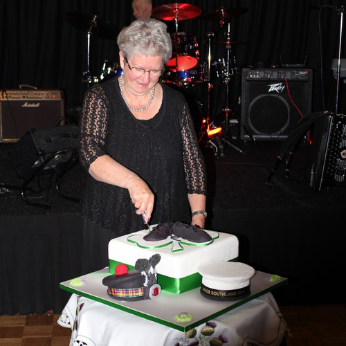 Jean Macnicol cutting the Conference cake
